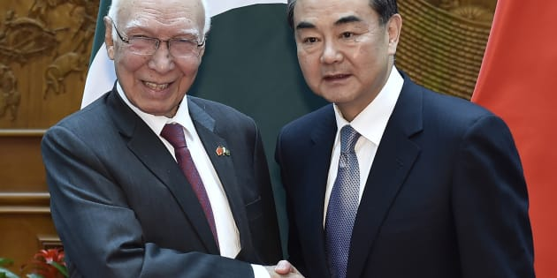 Pakistan Foreign Affairs Adviser Sartaj Aziz (L) shakes hands with Chinese Foreign Minister Wang Yi before a meeting at the Ministry of Foreign Affairs in Beijing on April 27, 2016. IORI SAGISAWA/AFP/Getty Images