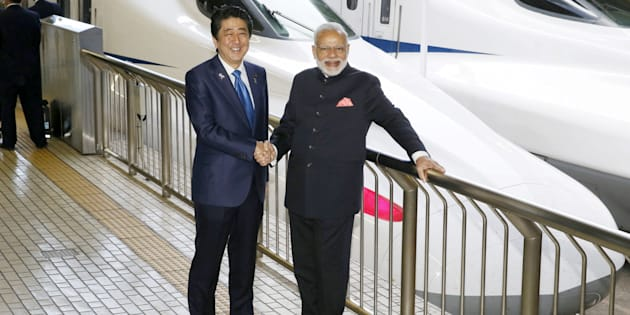 Indian Prime Minister Narendra Modi (R) and Japan's Prime Minister Shinzo Abe pose in front of a Shinkansen bullet train before heading for Hyogo prefecture at Tokyo Station, Japan November 12, 2016, in this photo taken by Kyodo.