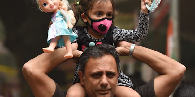 People wear pollution masks during the protest march for 'Your Right To Breathe' at Jantar Mantar, on November 6, 2016 in New Delhi, India.