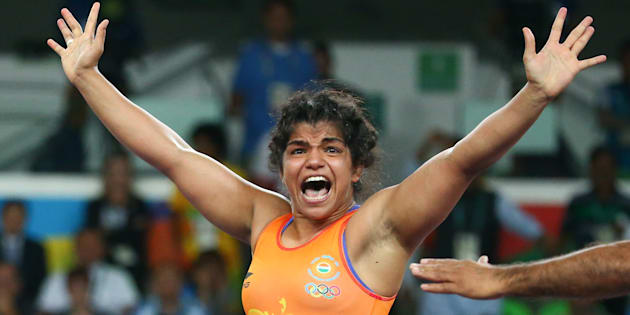 Sakshi Malik (IND) of India celebrates winning the bronze medal at the Rio Olympics after her victory against Aisuluu Tynybekova (KGZ) of Kyrgyzstan on 17 August, 2016.
