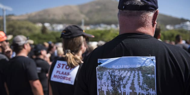 South African farmers and farm workers attend a demonstration at the Green Point stadium to protest against farmer murders in the country, on October 30, 2017, in Cape Town.