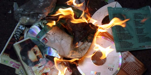 Members of MNS burn music disks of Pakistani artists during a protest against Pakistan government in Mumbai.