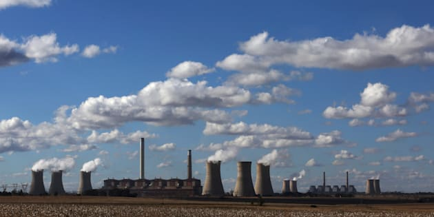 Steam rises from the cooling towers of Matla Power Station, a coal-fired power plant operated by Eskom in Mpumalanga province, South Africa, May 20, 2018.