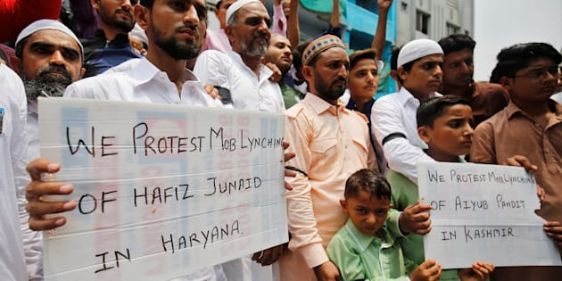 Muslims hold banners as they protest against the recent cases of mob lynching of Muslims who were accused of possessing beef, after offering Eid al-Fitr prayers in Ahmedabad, India June 26, 2017.