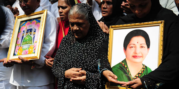 Indian Muslims hold a portrait of Tamil Nadu Chief Minister Jayalalitha Jayaram as they pray for her wellbeing as they stand in front of a hospital where she was being treated in Chennai on October 5, 2016. Jayalalithaa was hospitalised after complaining of fever and dehydration. / AFP / ARUN SANKAR        (Photo credit should read ARUN SANKAR/AFP/Getty Images)