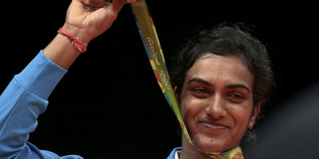 2016 Rio Olympics - Badminton - Women's Singles - Victory Ceremony - Riocentro - Pavilion 4 - Rio de Janeiro, Brazil - 19/08/2016. Silver medallist P.V. Sindhu (IND) of India poses with her medal.        REUTERS/Alkis Konstantinidis FOR EDITORIAL USE ONLY. NOT FOR SALE FOR MARKETING OR ADVERTISING CAMPAIGNS.