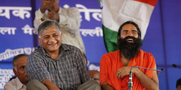 Baba Ramdev, right, seated next to retired former Indian Army chief General V.K. Singh during a protest in New Delhi in 2012. (AP Photo/Rajesh Kumar Singh)