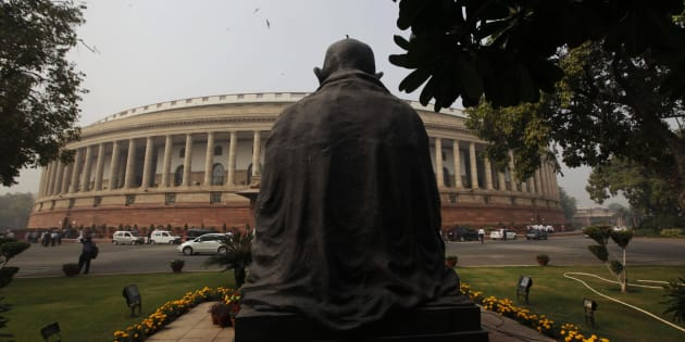 A bird sits on a statue of Mahatma Gandhi outside the parliament building in New Delhi, India, Tuesday, Nov. 22, 2011. The winter session of the Indian parliament began Tuesday. (AP Photo/Manish Swarup)