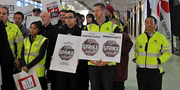 Workers at Melbourne Airport stop work earlier this year