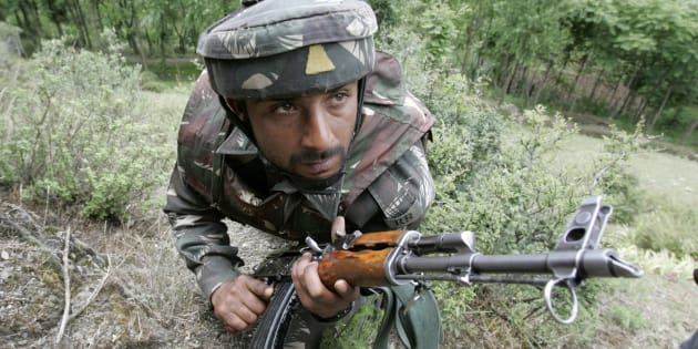 FILE PHOTO: An Indian army soldier takes up position during a search operation in Baramulla, about 55 km (34 miles) north of Srinagar, June 2, 2007.