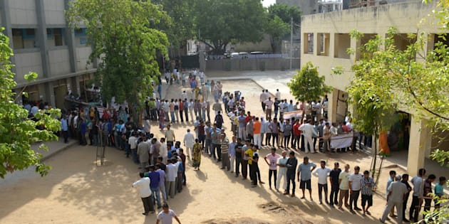 NEW DELHI, INDIA APRIL 23: Voters line up at a polling booth to cast their vote for MCD polls at Tuglakabad, New Delhi.(Photo by K Asif/India Today Group/Getty Images)