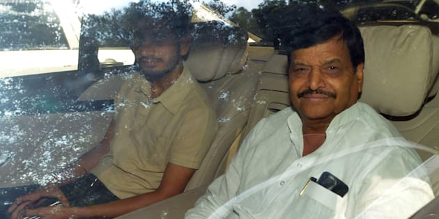 NEW DELHI, INDIA - SEPTEMBER 14: Uttar Pradesh Minister and Samajwadi party leader Shivpal Yadav with his son Aditya Yadav arrive during a high-level meeting with his brother and Samajwadi party Chief Mulayam Singh Yadav at Mulayam's house, on September 14, 2016 in New Delhi, India. UP CM Akhilesh Yadav stripped his uncle, Shivpal Singh Yadav, of three key ministerial berths late on Tuesday, in signs of growing fissures within Uttar Pradesh's ruling Samajwadi Party ahead of next year's assembly elections. (Photo by Sonu Mehta/Hindustan Times via Getty Images)