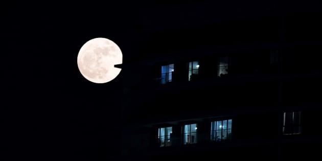 A supermoon rises in front of a high-rise building in Kolkata on November 14, 2016.