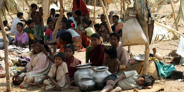 A group tribals sit in open at a camp in Dornapal in the central state of Chhattisgarh.