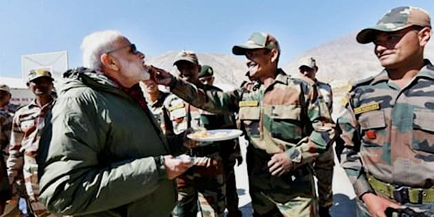 Sumdo: Jawans offer sweets to Prime Minister Narendra Modi on the occassion of Diwali, at Sumdo in Himachal Pradesh on Sunday. PTI Photo (PTI10_30_2016_000049B)