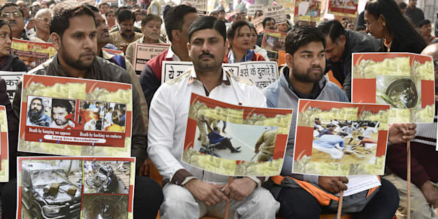 Supporters and workers holding placard during the protest against brutal attack on RSS-BJP workers in Kerala, at Kerala Bhavan on January 24, 2017 in New Delhi.