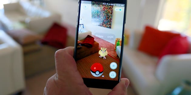 "The augmented reality mobile game ""Pokemon Go"" by Nintendo is shown on a smartphone screen in this photo illustration taken in Palm Springs, California U.S. July 11, 2016.  REUTERS/Sam Mircovich/Illustration"