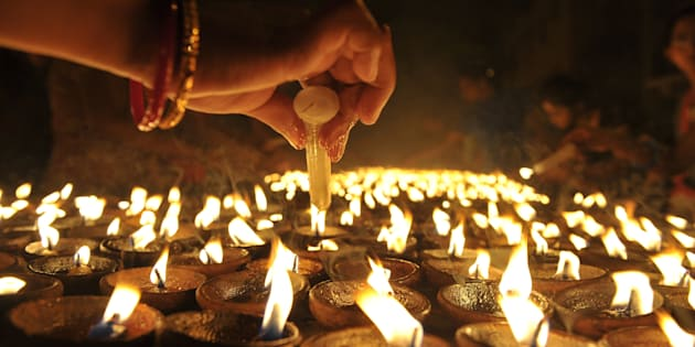 File photo of Indian Hindu devotees perform a ritual by lighting diyas - earthen lamps on Diwali.