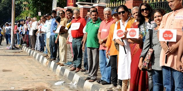 Bengaluru residents form human chain against the construction of a steel flyover.