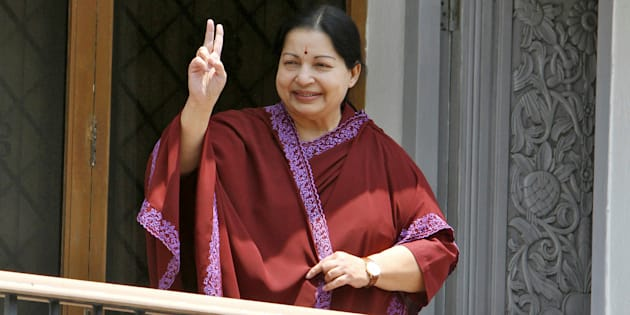 Jayalalithaa, leader of Anna Dravida Munetra Khazhgam (AIADMK) flashes a victory sign toward her supporters from the balcony of her residence after winning state election in the southern Indian city of Chennai May 13, 2011. REUTERS/Babu/File Photo