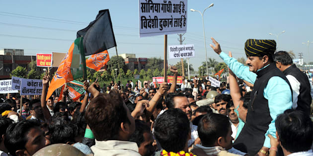 BJP MLA Bhawani Singh Rajawat demonstrating at Bharti-Walmart Store in protest of Foreign direct investment in multi-brand retail.