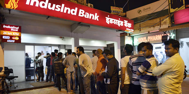 People queue up outside ATMs to withdraw hundred rupee notes at sector 12 on November 8, 2016 in Noida, India. (Photo by Mohd Zakir/Hindustan Times via Getty Images)