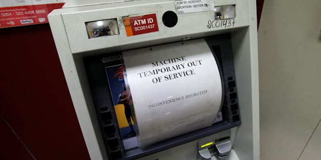 A notice is displayed on an ATM machine which is no longer dispensing cash in Chandigarh