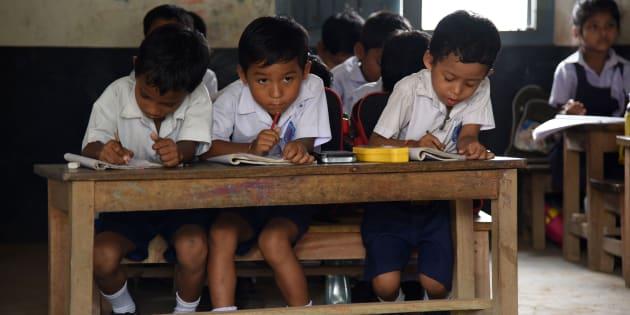 In this photograph taken on June 1, 2016, Indian schoolchildren and teachers take part in lessons in classrooms at Rashtriya Swayamsevak Sangh(RSS)run Sankardev Sishu Nikatan School in the Betkuchi area of Guwahati. / AFP / Biju BORO        (Photo credit should read BIJU BORO/AFP/Getty Images)