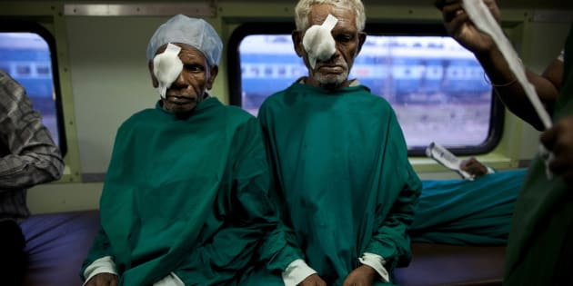 In this July 18, 2011 photo, Indian tribal villagers are bandaged after undergoing cataract surgeries inside the Lifeline Express, a charitable mobile hospital, in Jagdalpur, Chattisgarh state, India. The Lifeline Express, a five-coach train with specialist doctors and operating rooms, is the only hope for the nearly 1.4 million people of this forested eastern area stuck between Maoist violence and government apathy. (AP Photo/Kevin Frayer)