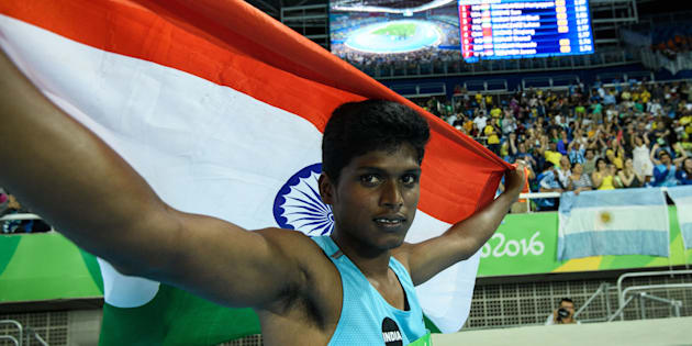 India's Mariyappan Thangavelu poses after winning the gold medal in the men's final high jump - T42 during the Paralympic Games at the Olympic Stadium in Rio de Janeiro.