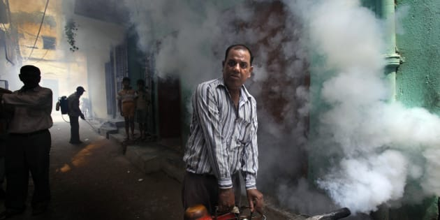 File photo of a Municipal Corporation of Delhi worker fumigating a residential area.