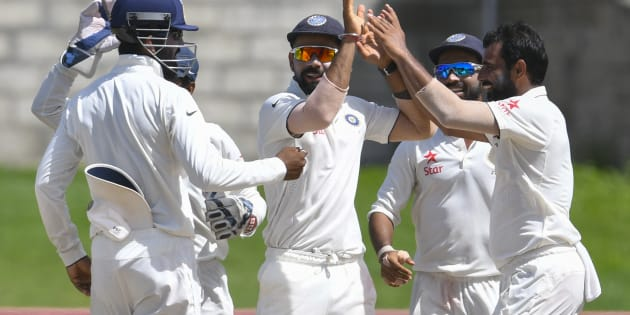 Virat Kohli (C) and Mohammed Shami (R) of India celebrate the dismissal of West Indies during the 5th and final day of the 3rd Test match.