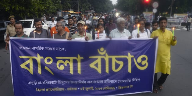 A group of activist participates in a candle light vigil against recent communal violence at Baduria of North 24 Parganas  in Kolkata.