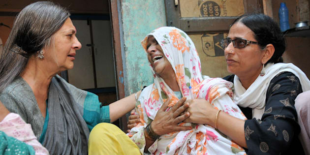 Polit Bureau member Brinda Karat consoling Zaira (C), mother of Junaid who was lynched by a mob while onboard a train,  in Haryana on Saturday.