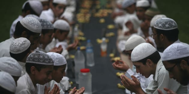 Muslims offer prayers before having their Iftar meal during Ramadan at a madrasa on the outskirts of Jammu August 8, 2012.