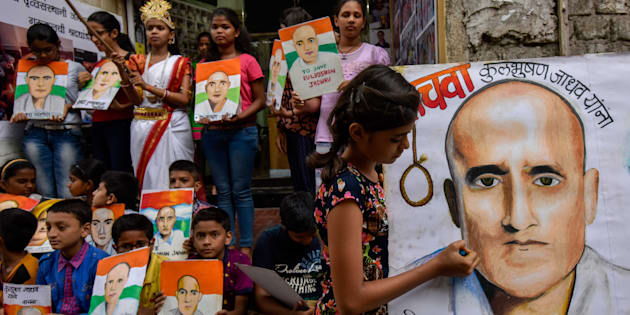 Photo of Kulbhushan Yadav by Gurukul students of art seen as part of a protest against his death sentence at Lalbaugh, on April 15, 2017 in Mumbai.