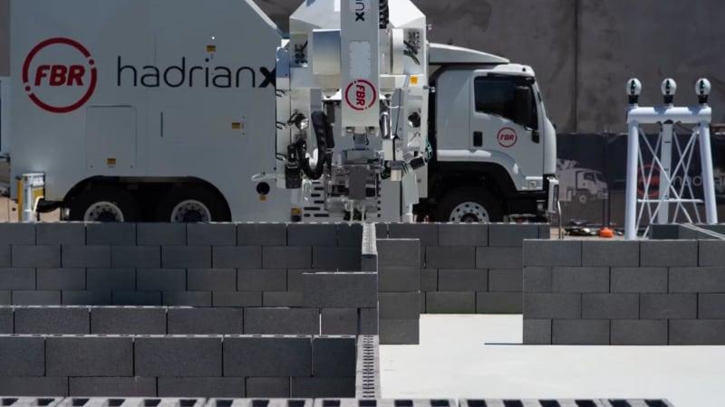 This robot lays bricks