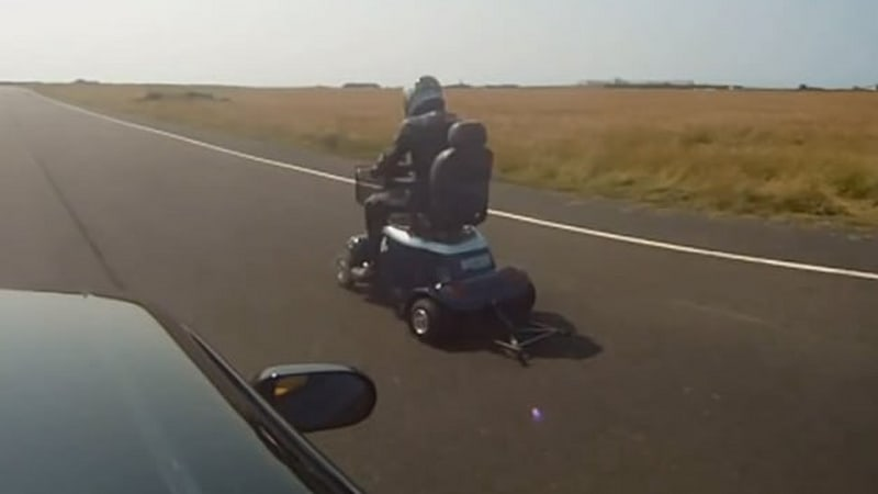 Watch this mobility scooter drag race a Nissan Skyline with surprising results