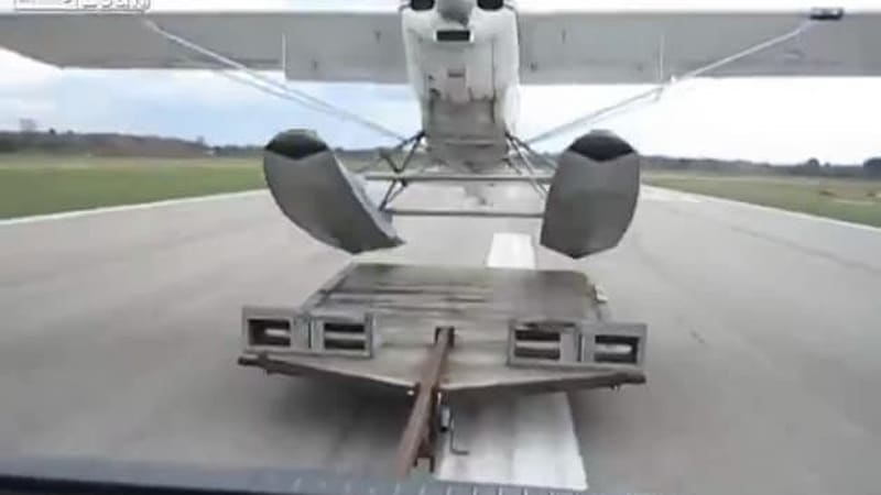 Watch a sea plane take off from a truck trailer