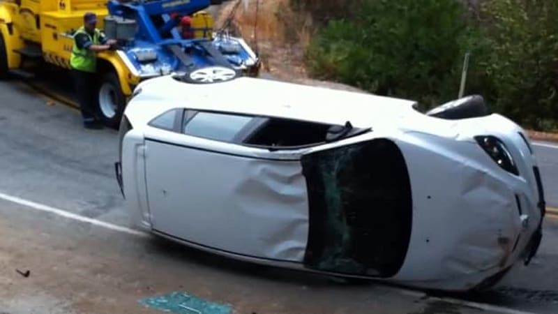 1fb5c2d8 Tow truck driver hilariously bad at righting a flipped Mazda - Autoblog
