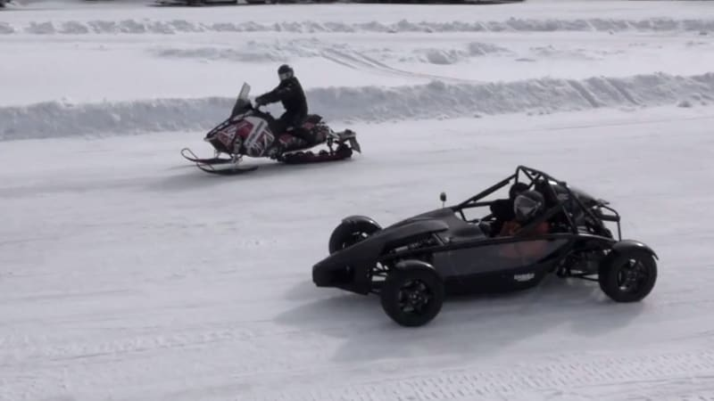 Ariel Atom on studded tires takes on snowmobile in drag race on ice