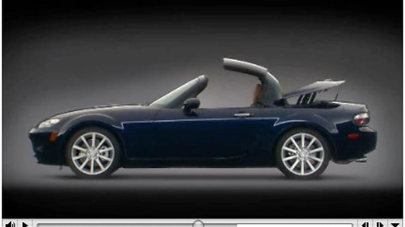 video mazda mx 5 roadster coupe retractable hardtop in. Black Bedroom Furniture Sets. Home Design Ideas