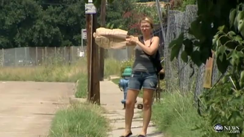 Houston woman warns motorists of speed trap with sign, gets thrown