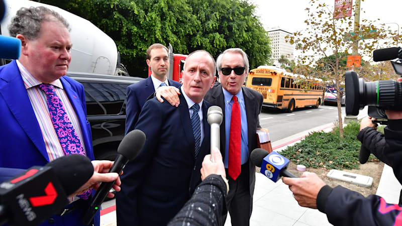 British cave diver Vernon Unsworth arrives at US District Court in Los Angeles, California on December 3, 2019, with his attorneys L.Lin Wood (R) and and Mark Stephen (L) during the defamation trial in the case of Tesla