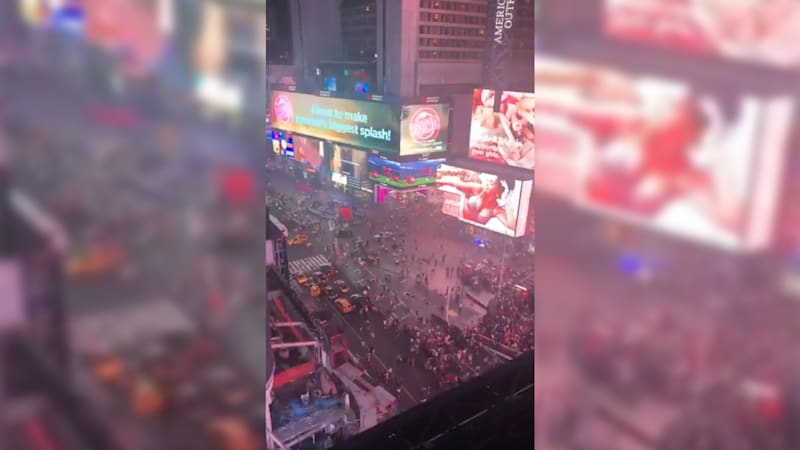 Times Square tourists flee after motorcycle sounds like