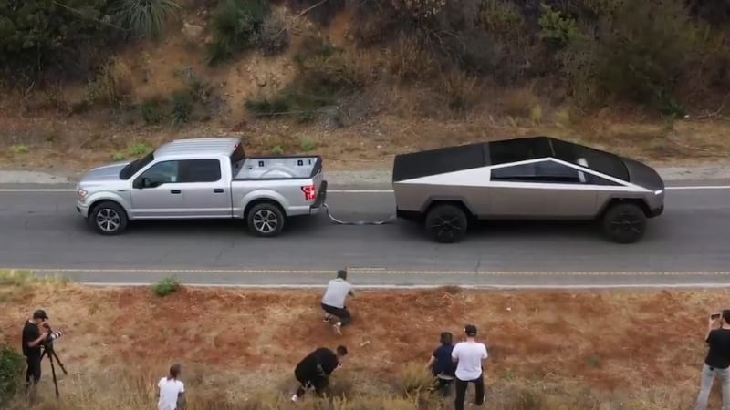 Tesla Cybertruck Wins Uphill Tug Of War With Ford F 150 In