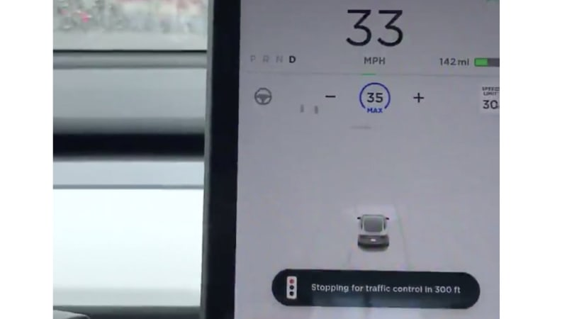 Tesla Full Self Driving shown stopping at red light in video