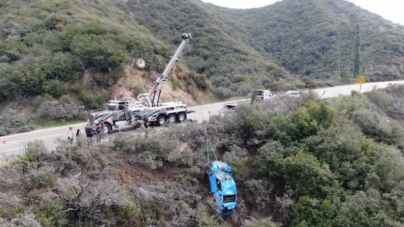 50-ton rotator truck pulls Ford Mustang Boss 302 out of canyon