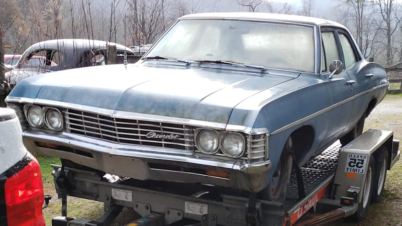 1967 Chevrolet Impala project towed.'