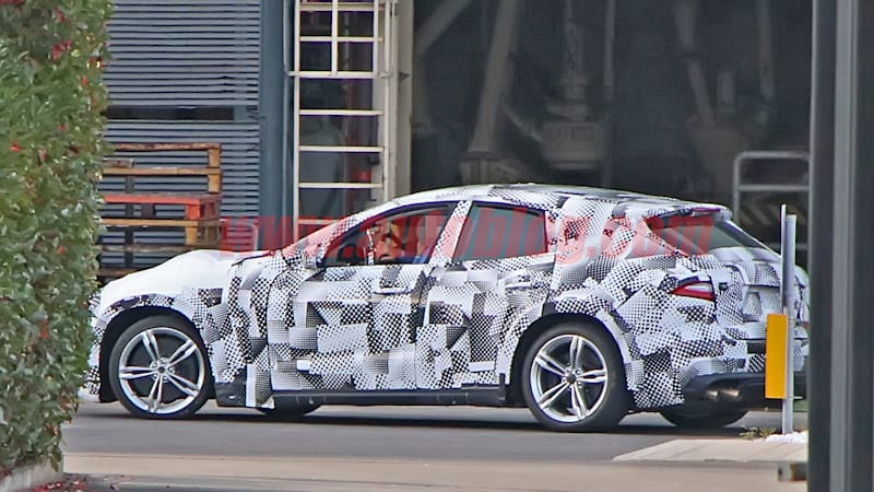 Ferrari Purosangue test mule spied using a Maserati Levante body
